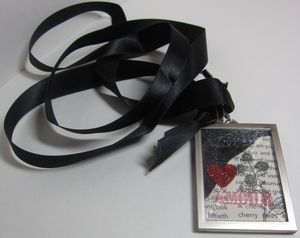 Simply adorned black with ribbon